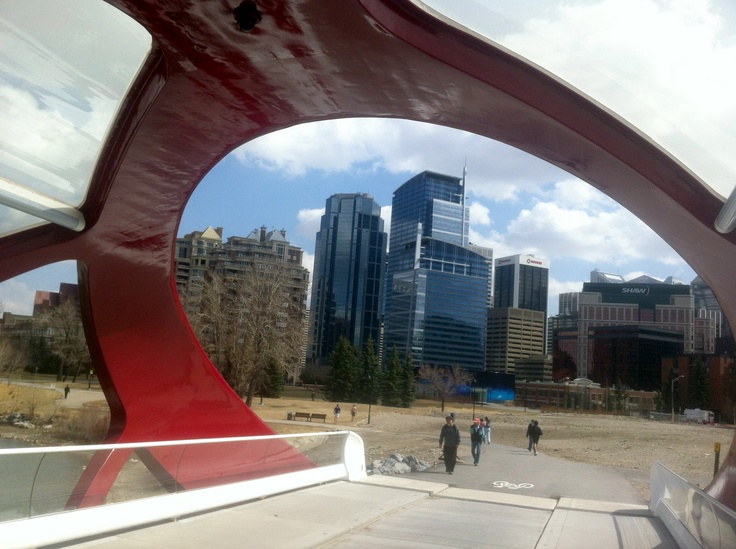 Calatava-designed Peace Bridge over Bow River, framing downtown office buildings. More at http://calgary.foundlocally.com/Images/default.asp?Page=1=peacebridge