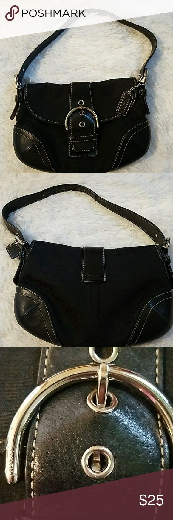 Coach signature purse Excellent condition!!! Black Coach purse with silver hardware and  black Coach tag attached.  This bag has one pocket inside with zipper and 1 separate compartment. Coach Bags Mini Bags