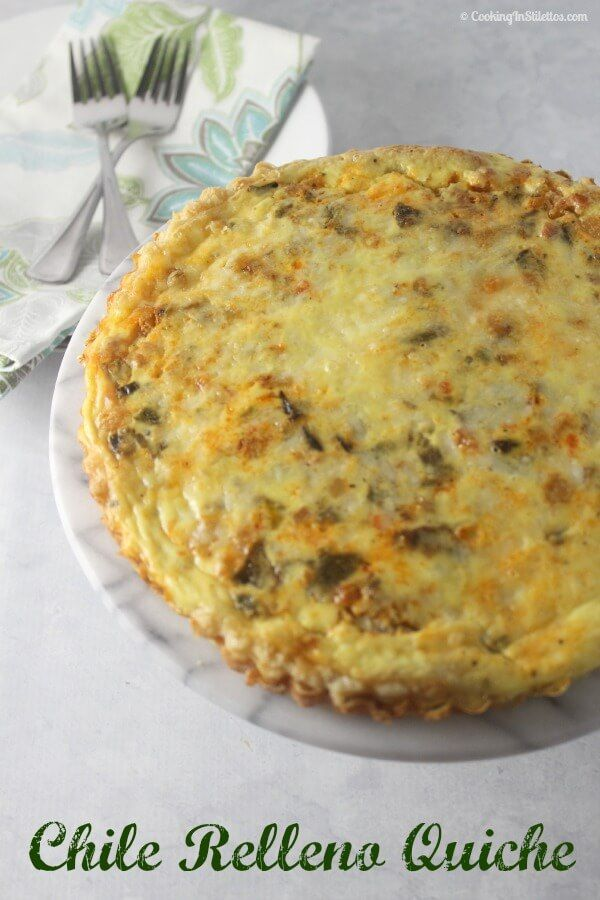 Chile Relleno Quiche is a brunch showstopper.  Roasted poblanos and pancetta nestled in a puff pastry crust with eggs and sharp cheddar cheese.    Cooking In Stilettos #BrunchWeek