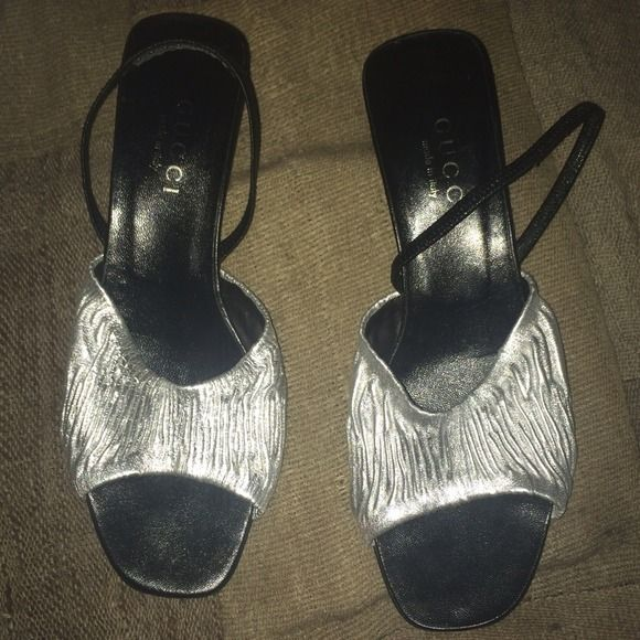 """Gucci silver metallic slingback pumps. This is a pair of Gucci silver metallic slingback pumps with a 2"""" heel. They were only worn once, so they pretty much look brand new aside from very minor wear on the soles. Adorable! Gucci Shoes Heels"""