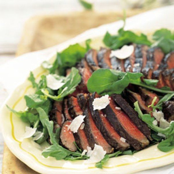 Tradition dictates that these Florentine-style steaks be cooked over a grate in a fireplace, but this recipe translates very well to an American-style outdoor grill. Use a vegetable peeler to cut thin strips from a wedge of Parmesan to make the cheese shavings. What to drink: Chianti Classico.