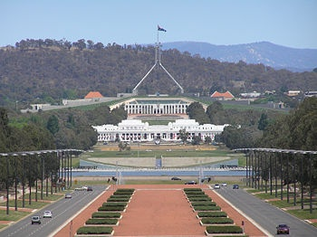 Photo 1: Parliament House, Canberra, ACT, behind Old Parliament House: The Australian Capital Territory (ACT) was born of a dispute between Sydney & Melbourne competing to become the capital of the newly independent/federated Australia.  A compromise was to carve a small chunk out of NSW's Limestone Plains 280km SW of Sydney to become the site for Canberra - the country's smallest self-governing territory…