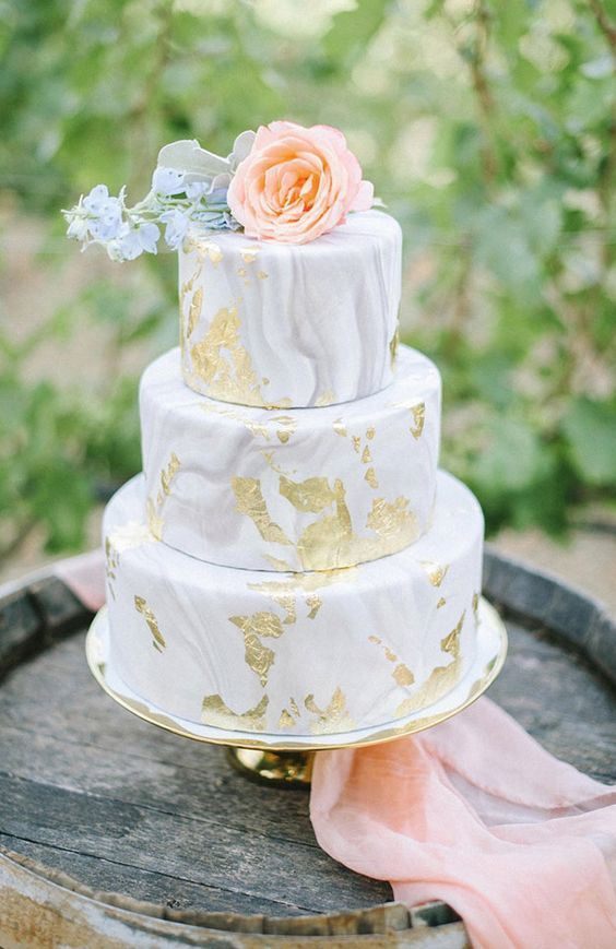 Unique grey marble three tier wedding cake with creative gold detail; Featured Photographer: Danielle Yashar