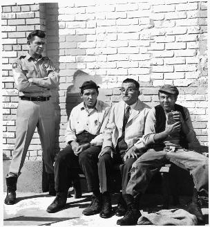"The cast of ""The Andy Griffith Show"": Don Knotts as Deputy Barney Fife, Howard McNear as Floyd Lawson, Andy Griffith as Sheriff Andy Taylor, Howard Morris as Ernest T Bass"