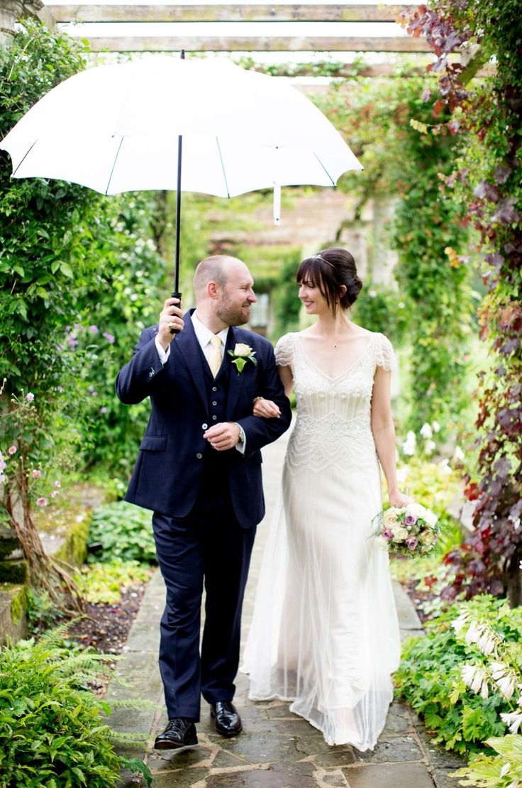 Bride and Groom from a 1920's Rainy Day Prohibition Party Inspired Wedding. Photography by Helen Cawte