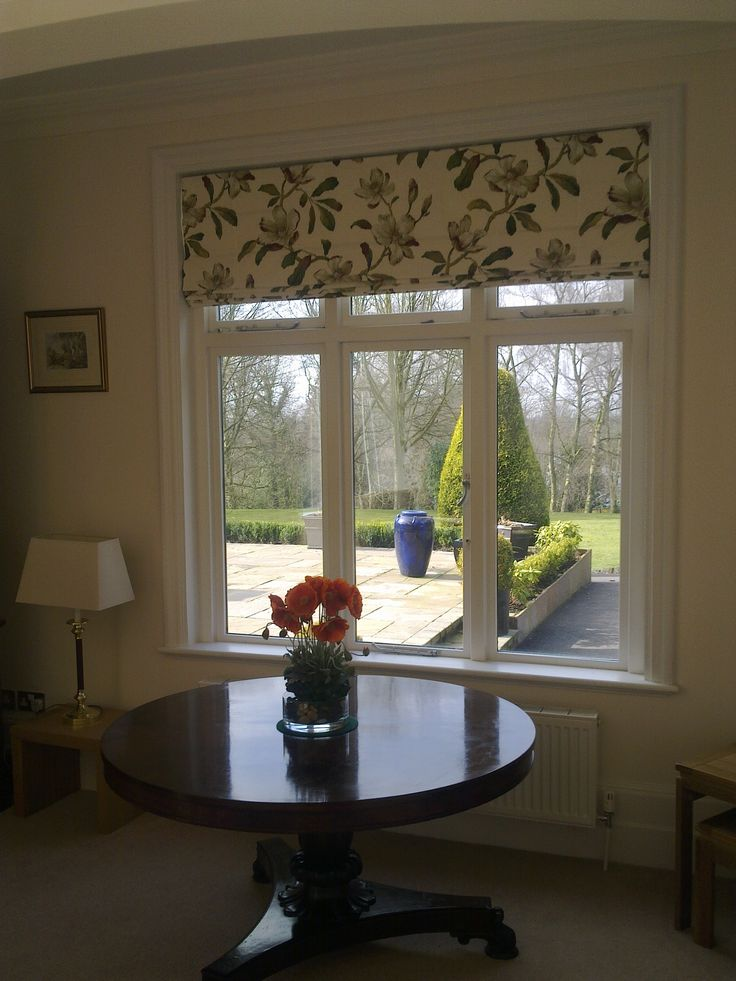 Traditional But Stylish Roman Blind Set Within Window Recess To Reveal Architectural Detail