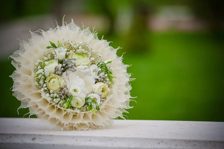 Bridal bouquet with ivory skeleton leaves, wool, ranunculus, peonies, brunia, baby breath, eustoma by Atelier Floristic Aleksandra  concept Alexandra Crisan