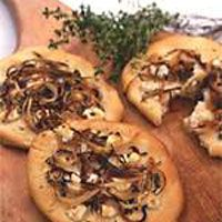 Focaccia is simply a chewy, pizza-style flatbread without the typical toppings. Here, we've laced the dough with fresh thyme and sprinkled the top with more thyme, caramelized onions, and goat cheese.