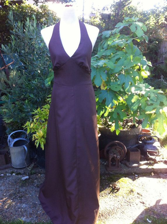 Sexy chocolate brown halter neck maxi dress with tie back sash. It fastens at the back with a nylon zipper. This is a lovely dress with a