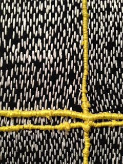 Chiyu Uemae, hand stitched with white and yellow thread on black fabric