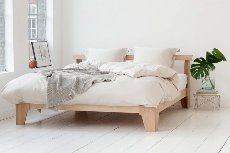 Yumeko sustainable bed linen   industrial building Amsterdam   high ceiling with traditional windows   white bedroom   loft