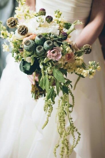 Unique Semi Cascading Wedding Bouquet: White Florals, Peach Ranunculus, Dusty Pink Ranunculus, Yellow Stock, Scabiosa Pods, Green Poppy Pods, Green Amaranthus, Greenery and Foliage
