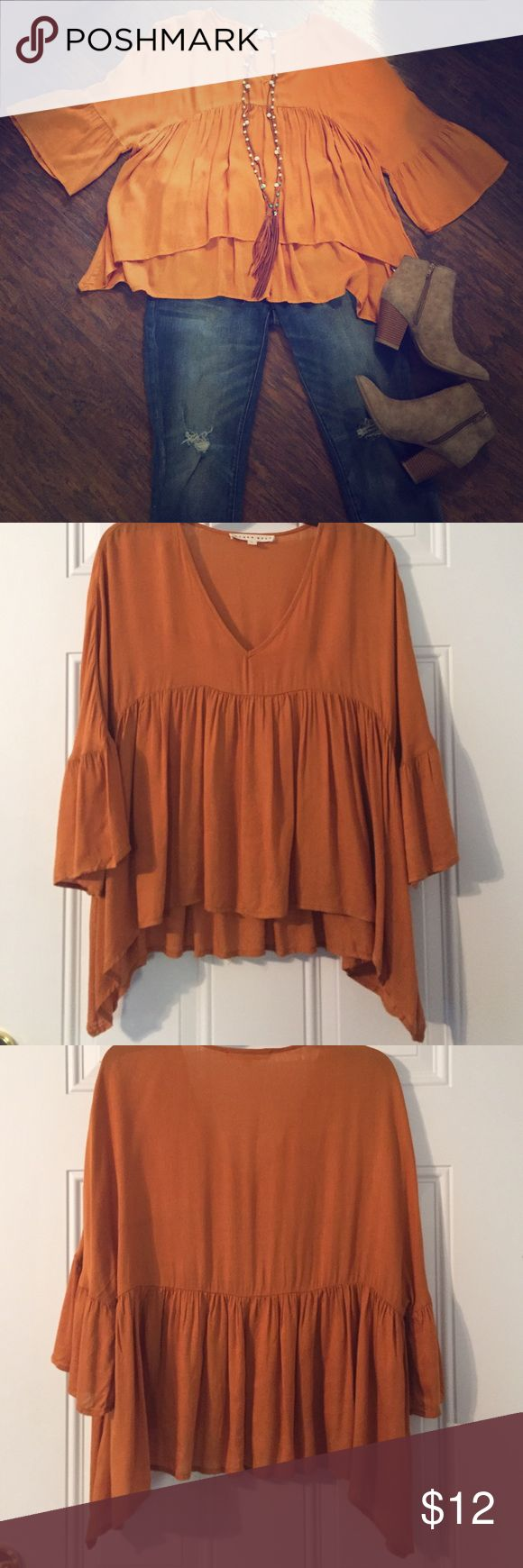Peplum style top! Three quarter length sleeve top with peplum waist.  Gorgeous mustard fall color.  I loved this top soo much I bought it in large!  I didn't care.  However, after wearing it a couple of times, I see that the fit is not good on me!  Still super cute!!  100% rayon, hand wash and line dry.  I have hand washed it once.  There is a tiny stain on the sleeve.  I didn't have any spot remover so it's possible it could still come out. blush noir Tops Blouses