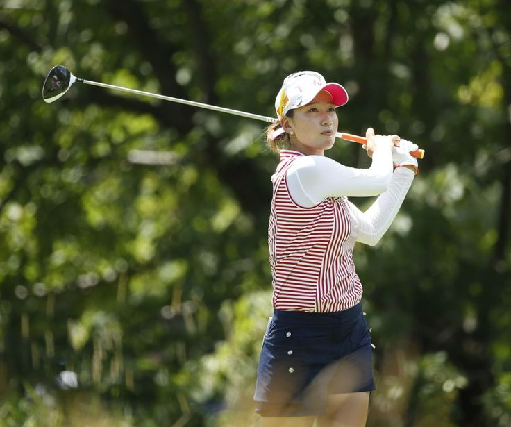 Chella Choi, of South Korea, watches her tee shot on the fifth hole during the third round of the Women's PGA Championship golf tournament at Olympia Fields Country Club Saturday, July 1, 2017, in Olympia Fields, Ill. (AP Photo/Charles Rex Arbogast)
