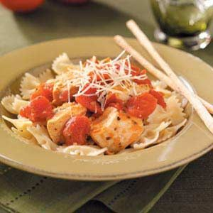 "Herbed Chicken and Tomatoes Recipe -Rebecca Popke of Largo, Florida puts a tangy spin on chicken by adding just a few easy ingredients. ""Recipes such as this are really a plus when you work a full-time job but still want to put a healthy, satisfying meal on the table,"" she explains."