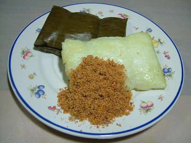 In my hometown of Bogor - West Java, we call this buras cocol is rice patty with dry coconut dip