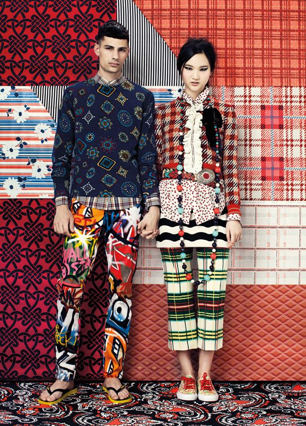 Print on print fashion shoot. Folk style clashing prints, tartan and 70's style wallpapers.