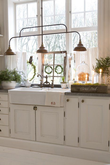 White Apron Sink, Dark Counters, Copper Light Fixture.
