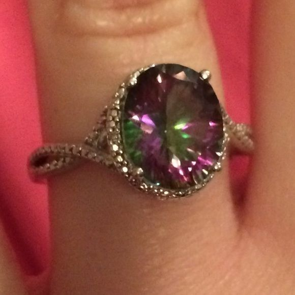 Mystic Fire Topaz Ring Mystic Fire Topaz ring with silver detail - no side stones. Colors are mostly purple and green. Sterling silver. Purchased from Kohls and only worn a handful of times. Jewelry Rings