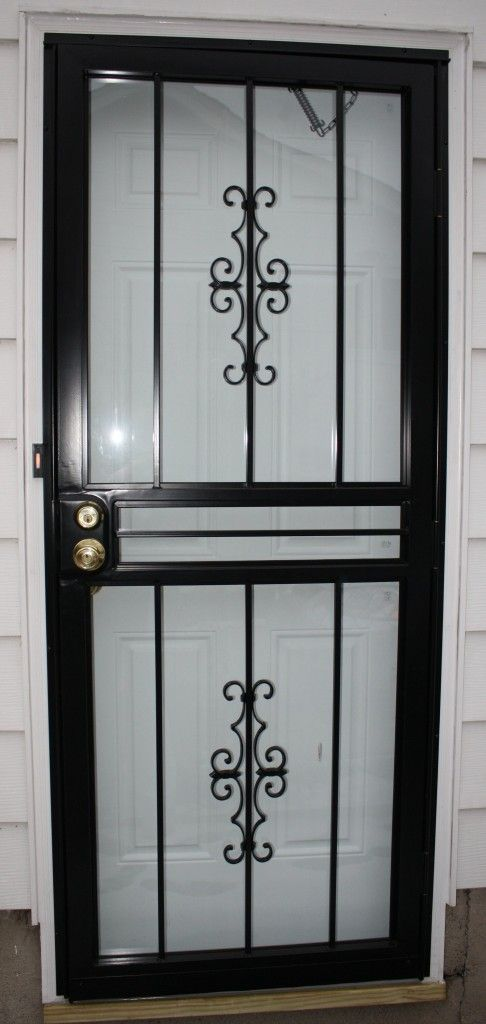 http://www.ireado.com/stylish-security-storm-doors-make-your-home-more-safety/ Stylish Security Storm Doors Make Your Home More Safety : Black Wrought Iron Security Storm Door Security Storm Doors
