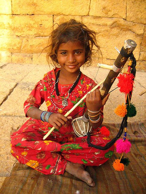 Desert Song.  A young tribal musical performer at the gate to Jaisalmer fort, Rajasthan, India ~ one of the largest forts in the world and one of Rajasthan's most popular tourist attractions with as many as five to six hundred thousand tourists visiting it annually.