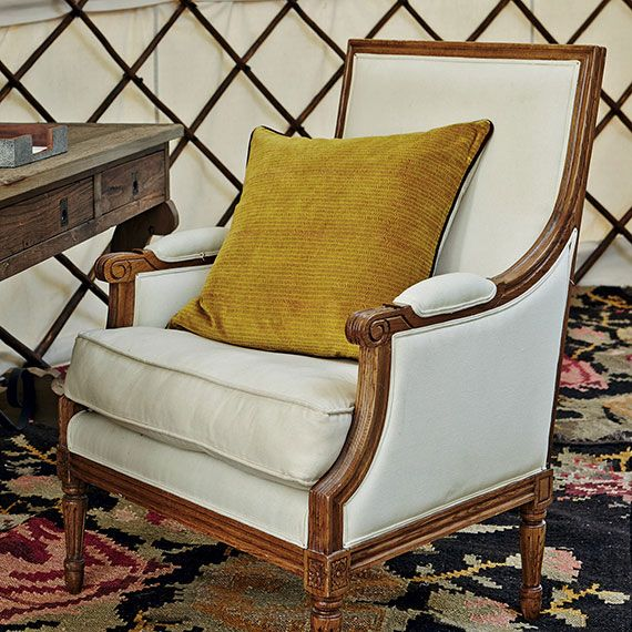 Period detailing coupled with soft upholstery makes for a comfortable yet classic chair. #oka #armchair #sale