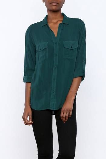 Deep teal blouse with a button down front, flap pockets and long button tab sleeves.