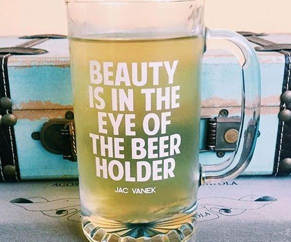 "We're all beautiful in one way or the other - but especially when sipping a frosty brew from this ""eye of the beer holder"" glass. The clever quip is printed in high quality waterproof vinyl onto a heavy duty two and a half pound beer mug."