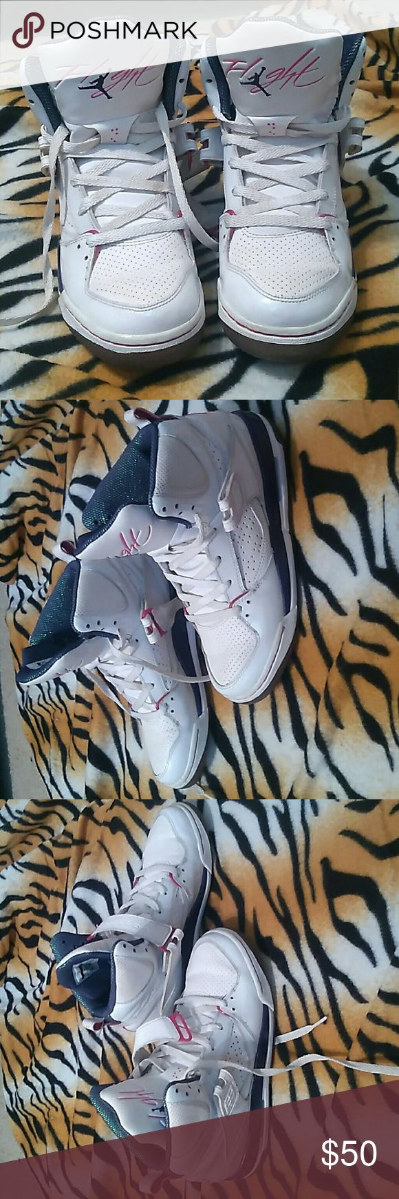 Jordans Pink purple and white Jordan's. Only worn 4 or 5 times. In good condition. Could use some new shoe laces though. Jordan Shoes Sneakers