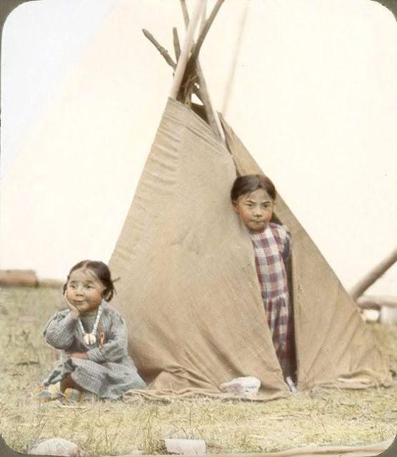 Blackfeet indian girls playing house in their *pretend' tepee