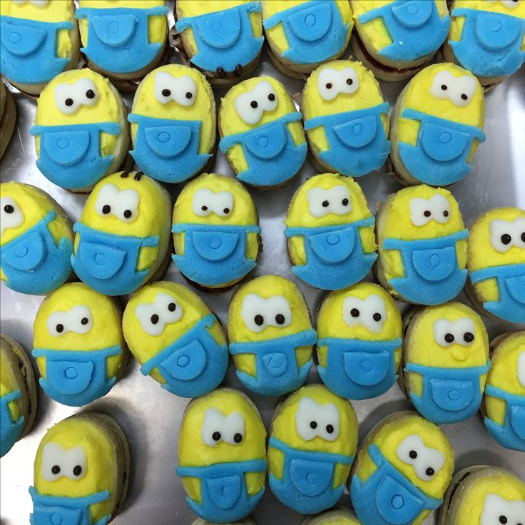 Minion cookies. Vanilla shortbread and jam cookie sandwich decorated with house made fondant.