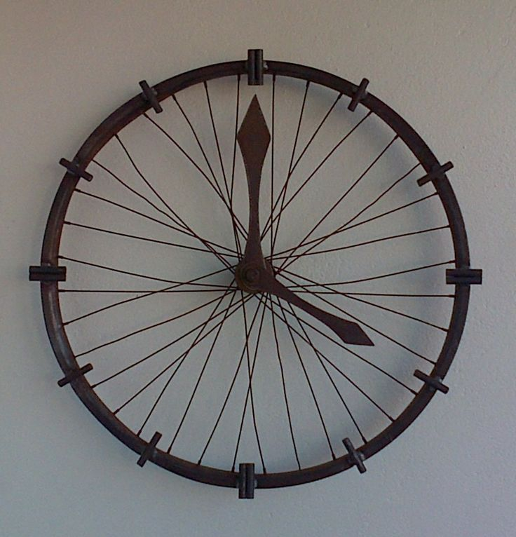ornamental clock made form an old rusted bicycle rim