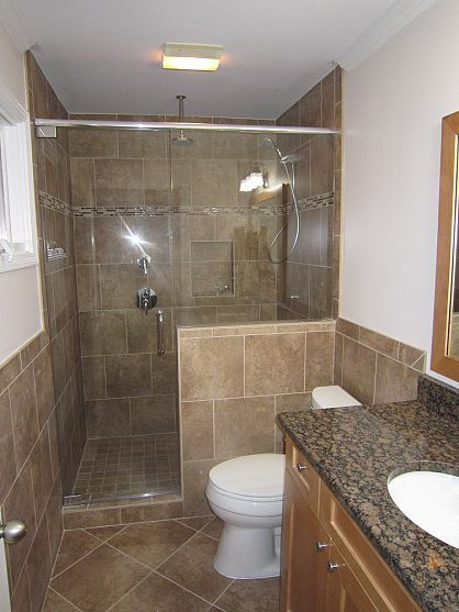 Idea for bathroom remodel. looks like our cabinetry from upstairs. too much tile; wood floor?