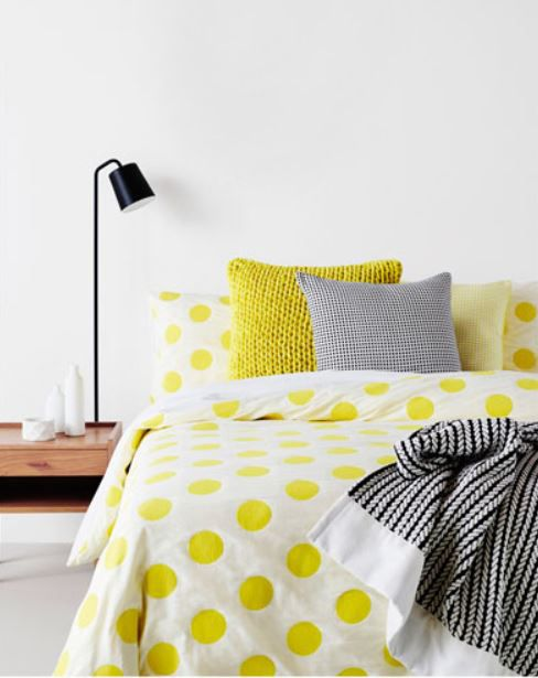 make matching colpop bedhead and spread. low side table and tall table or short floor lamp. mix accent cushions, contrast throw