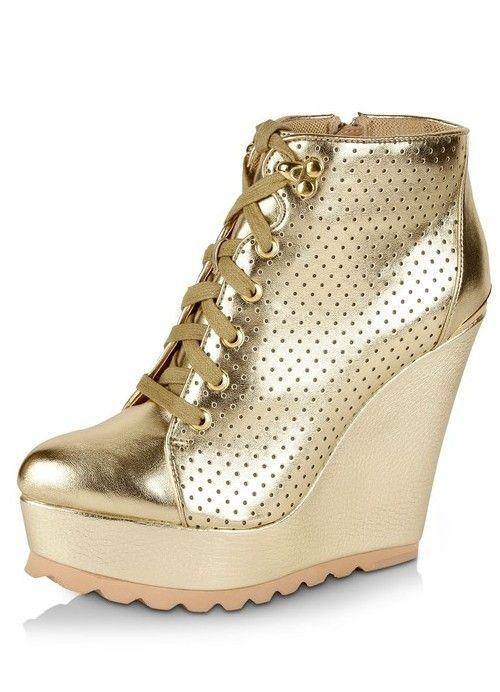 Trending perforated metallic wedge-heels sneakers  via @Roposo @STEVE MADDEN