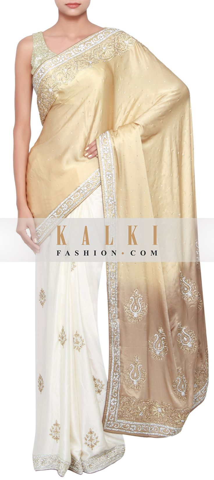 Buy Online from the link below. We ship worldwide (Free Shipping over US$100) http://www.kalkifashion.com/white-and-liquid-gold-shaded-saree-embellished-in-kundan-and-stone-only-on-kalki.html