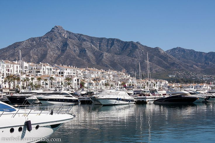 Boats in Puerto Banus with mountain at background
