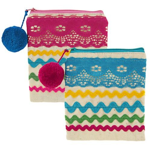 """Cute, colorful, and nostalgic, our pouch is a perfect catch all for all the little things you need to carry. Available in pink and blue!    Made of 100% cotton.   Measures 5"""" H x 4.5"""" W.   Handmade in and fairly traded from Guatemala by El Sol Maya.   El Sol Maya works with a group of fif..."""