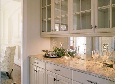 Antique mirror backsplash in butler\'s pantry.