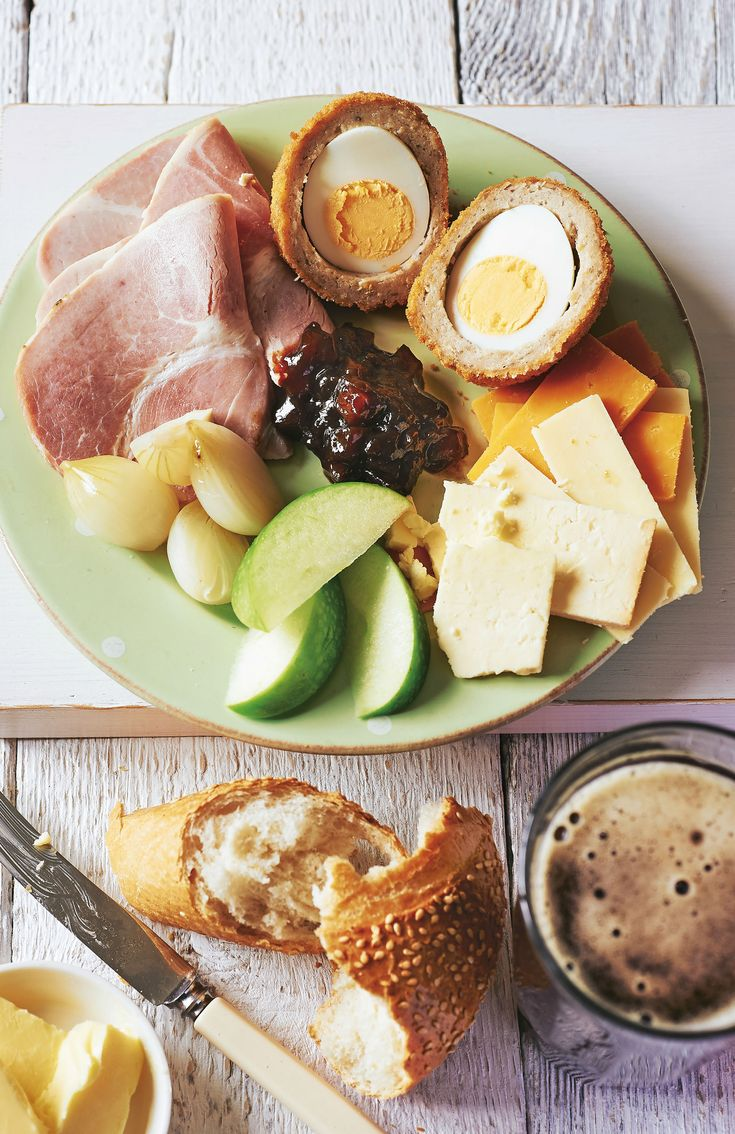 PERFECT PLOUGHMAN'S LUNCH: Pork pie Scotch egg Ham slices Pickled onions Chopped tomato Mature cheddar cheese and Red Leicester slices Branston's pickle Crusty bread Apple or two Apricot yoghurt Ginger beer