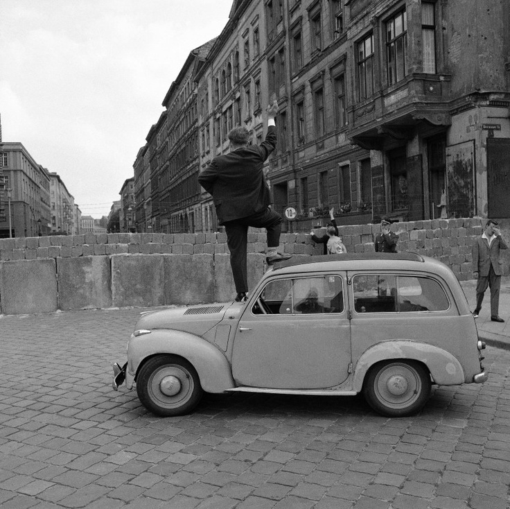 Looking over the Berlin Wall into the eastern sector, Germany, cool vehicle, oldie, photo, black and white, city view, up high, symbolism, never forget, history