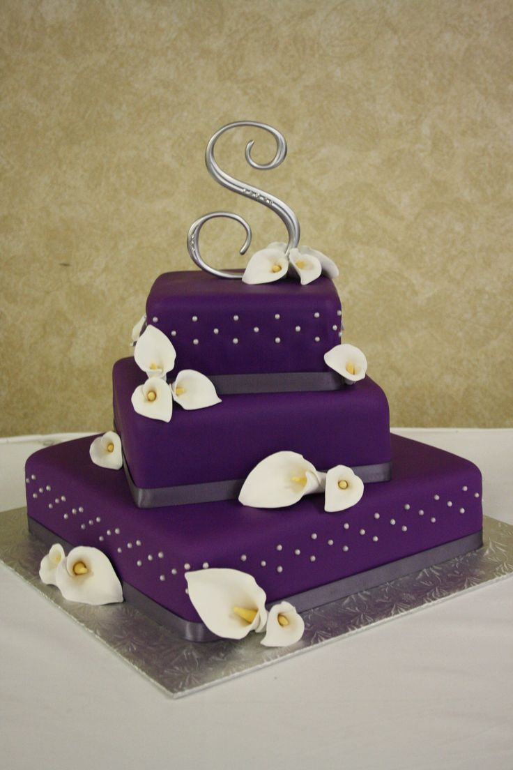 wedding cake - purple wedding cake with hand made calla lilies http://www.invitesweddings.com/b/wedding-cakes/purple-wedding-cakes