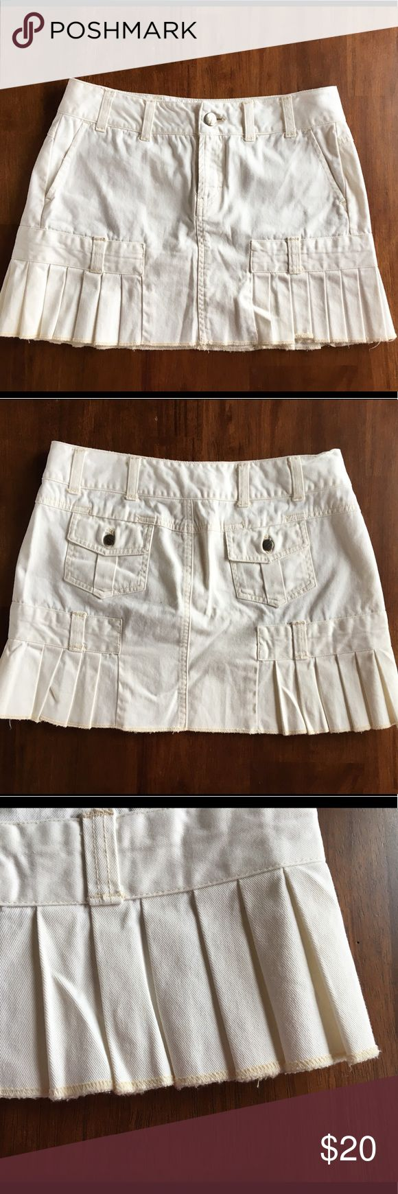 "AEO Off-White Denim Pleated Mini Skirt Size 4 American Eagle Outfitters  Off-white denim mini skirt Size 4 Pleated Approximately 14"" long  If you need additional pictures or measurements please feel free to ask 😊 American Eagle Outfitters Skirts Mini"