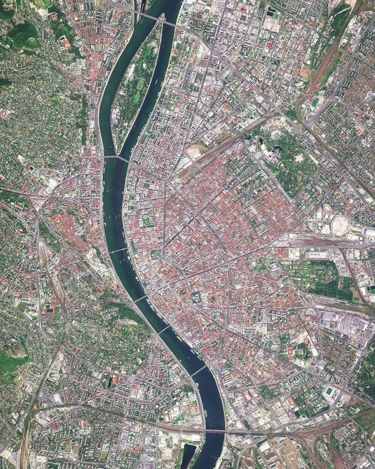 """Budapest is the capital of and most populous city in Hungary, as well as one of the largest cities in the European Union. It is home to more than 1,750,000 people and the birthplace of Ernő Rubik, inventor of the Rubik's Cube. The Danube River enters Budapest from the north and encircles several islands, including Margaret Island, which can be seen at the top of this Overview.  Instagram: https://bit.ly/2qM85eX  47°31'07.2""""N, 19°03'14.9""""E  Source imagery: DigitalGlobe"""