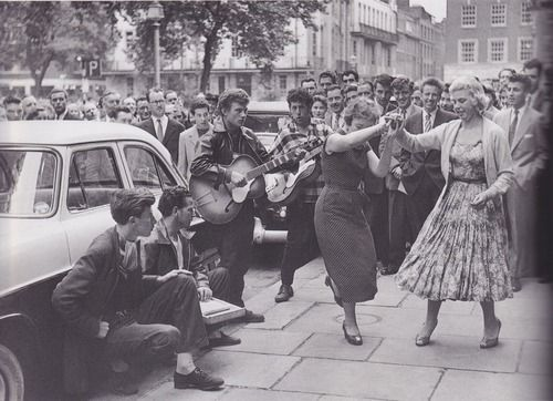 Teens dancing in the street (1950s)