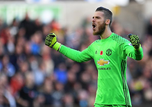 CELE Manchester United's David De Gea celebrates the opening goal scored by Paul Pogba during the Premier League match between Swansea City and...