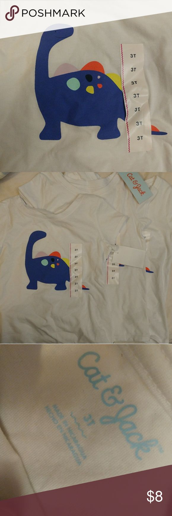 Three 3t dinosaur t-shirts, bnwt Really cute dinosaur t-shirts from Cat and Jack. There are three identical t-shirts, perfect for cousins, siblings, or pals. They're neutral as well, and would be great for boys or girls. Preference would be to sell as a lot of all three. Please let me know if you have any questions or need more pictures! Thanks! cat and jack Shirts & Tops Tees - Short Sleeve