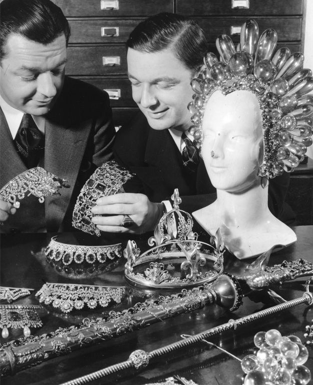 "Eugene Joseff and his brother Jimmy Glaser looking at their wares. The huge acrylic headpiece was worn by Virginia Bruce in 1936's ""The Great Ziegfeld."""