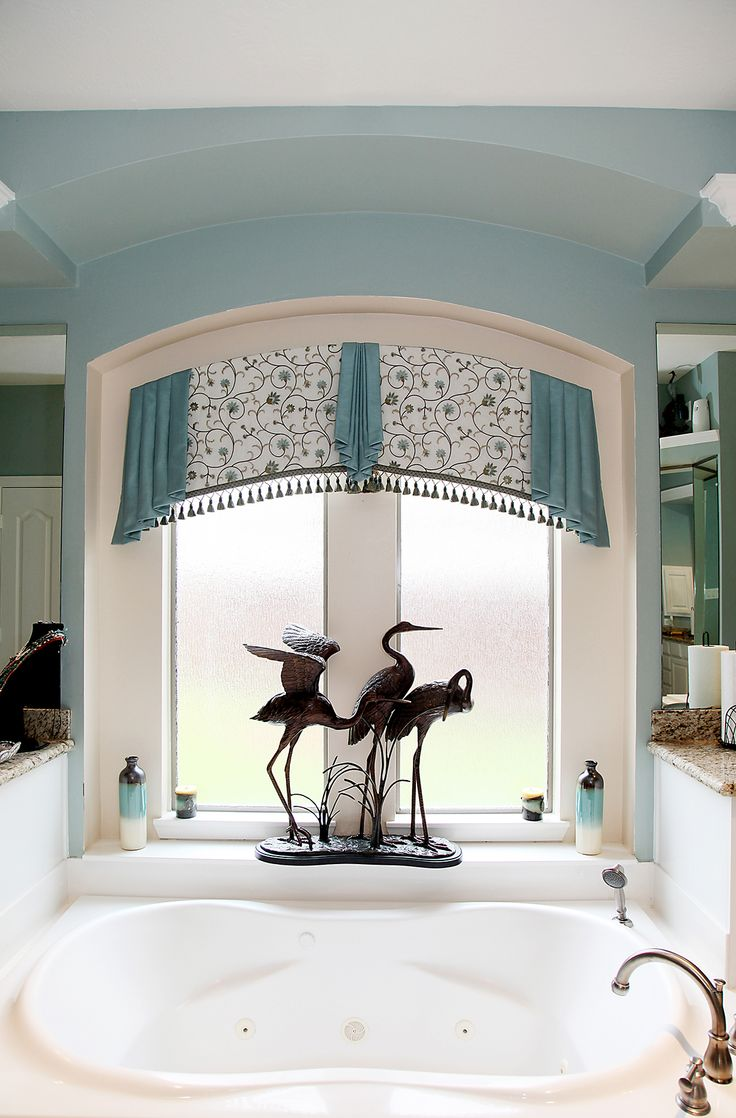 The delicate floral themed embroidery, fringe tassels and pleated accents in this custom cornice and drapery design will make you feel like you are on vacation every day you spend soaking in your bath tub. The soft blues and whites in this bathroom remind me of the ocean. Contact Mary Allen of Star Furniture in Houston, TX for complimentary drapery design services.