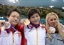 Women's 400m Individual Medley medallists pose during Victory Ceremony  (L-R) Bronze medalist Xuanxu Li of China, gold medalist Shiwen Ye of China and silver medalist Elizabeth Beisel of the United States celebrate during the Victory Ceremony for the women's 400m Individual Medley on Day 1 of the London 2012 Olympic Games at the Aquatics Centre.